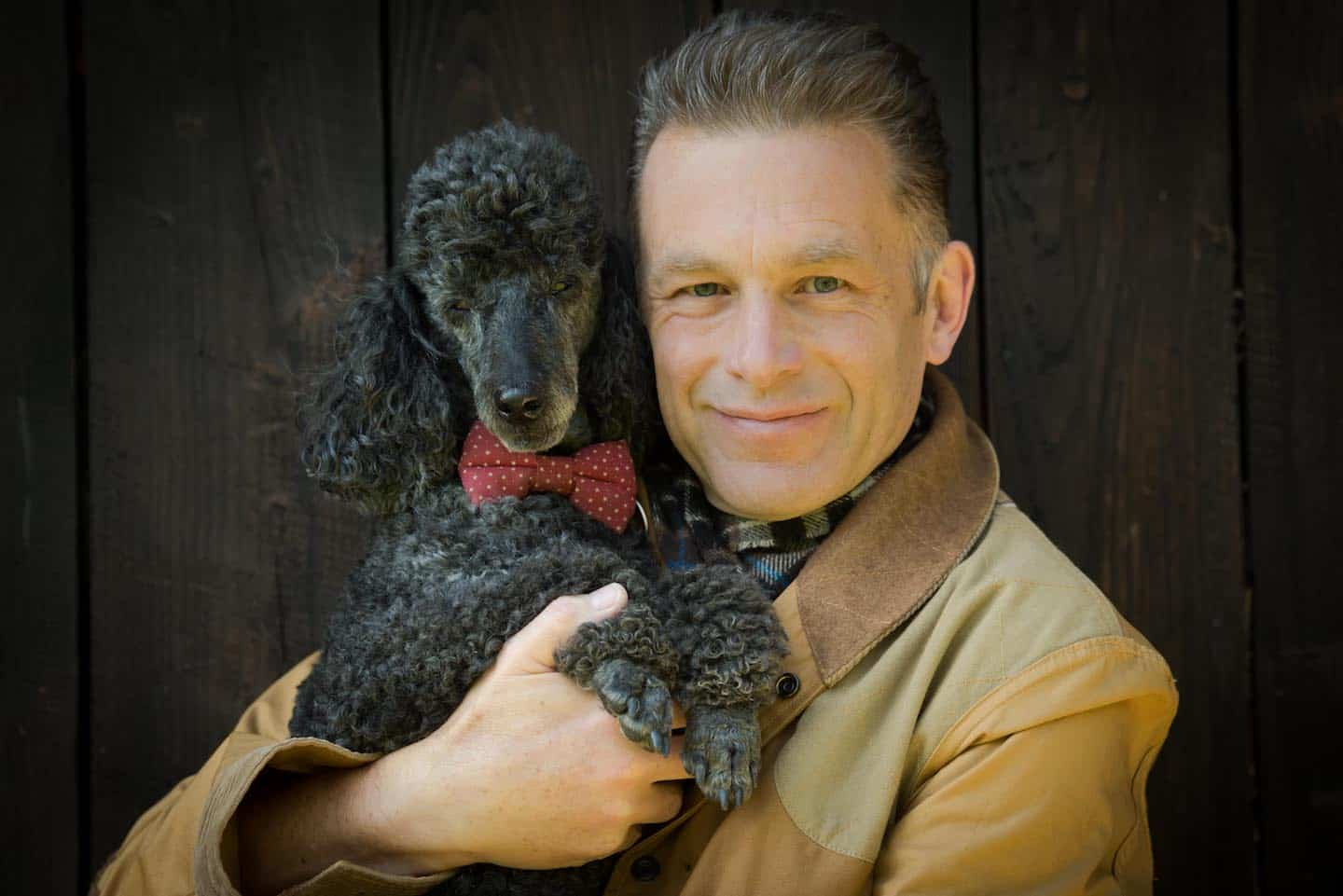 7 Dog-Friendly Things to Do In The New Forest - Chris Packham Cuddling Scratchy Close Up