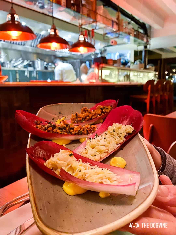 Handpicked crab served on bitter crisp endive - The Melusine