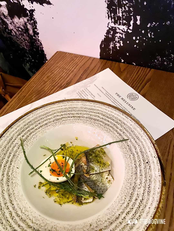 Pickled herring with half soft boiled egg - The Melusine